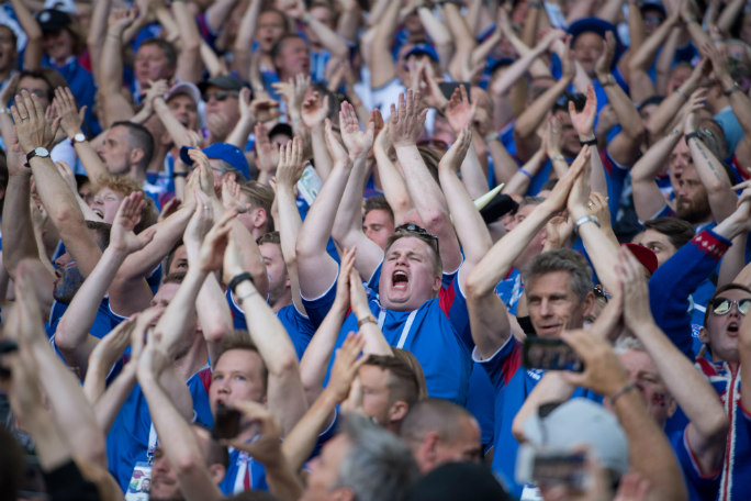 Iceland fans perform the thunderclap. Photo: Alamy