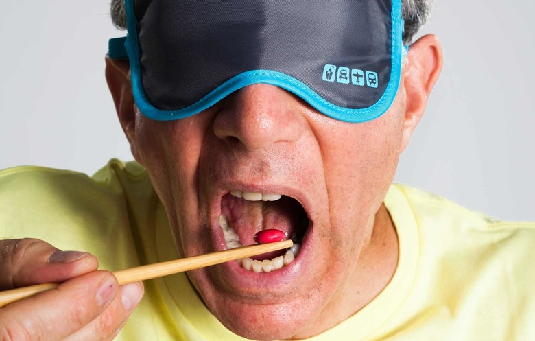 Most Smarties/M&Ms eaten in one minute blindfolded using chopsticks