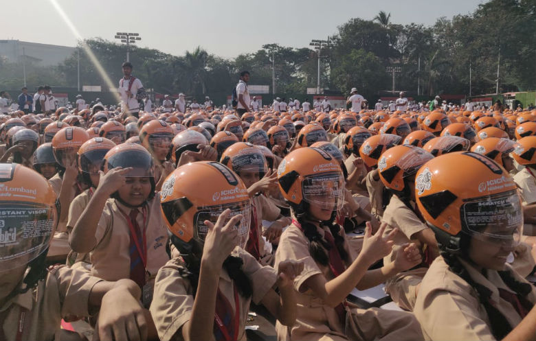 Largest gathering of people wearing helmets